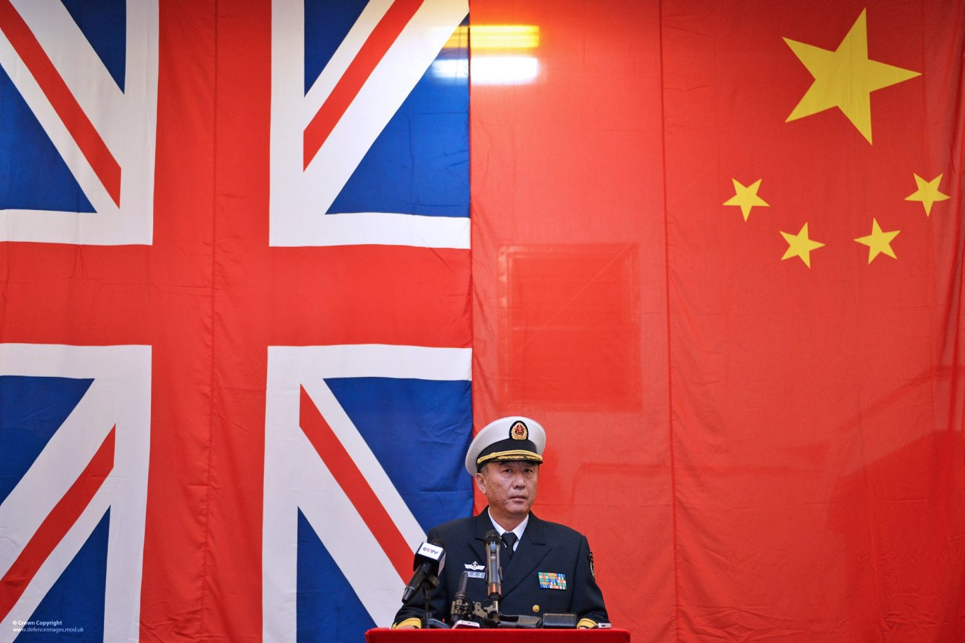 The Commanding Officer of the Chinese warship PLA Navy Ship Chang Bai Shan, Rear Admiral Zhang Chuansha addresses a press conference in Portsmouth.  On 12th January 2014  three Chinese warships were welcomed into Portsmouth on an official visit. The Chinese Ambassador Mr Xiaoming Liu and Defence Attaché Maj Gen Yao Min greeted the ships and visited the Landing Platform Ship PLA Navy Ship Chang Bai Shan.   The Royal Marines Band performed to members of the Chinese community from all around the UK,  before the ships was open for tours. ------------------------------------------------------- © Crown Copyright 2014 Photographer: LA(PHOT) Keith Morgan Image 45158369.jpg from www.defenceimages.mod.uk    Use of this image is subject to the terms and conditions of the MoD News Licence at www.defenceimagery.mod.uk/fotoweb/20121001_Crown_copyright_MOD_News_Licence.pdf   For latest news visit www.gov.uk/government/organisations/ministry-of-defence Follow us:  www.facebook.com/defenceimages www.twitter.com/defenceimages
