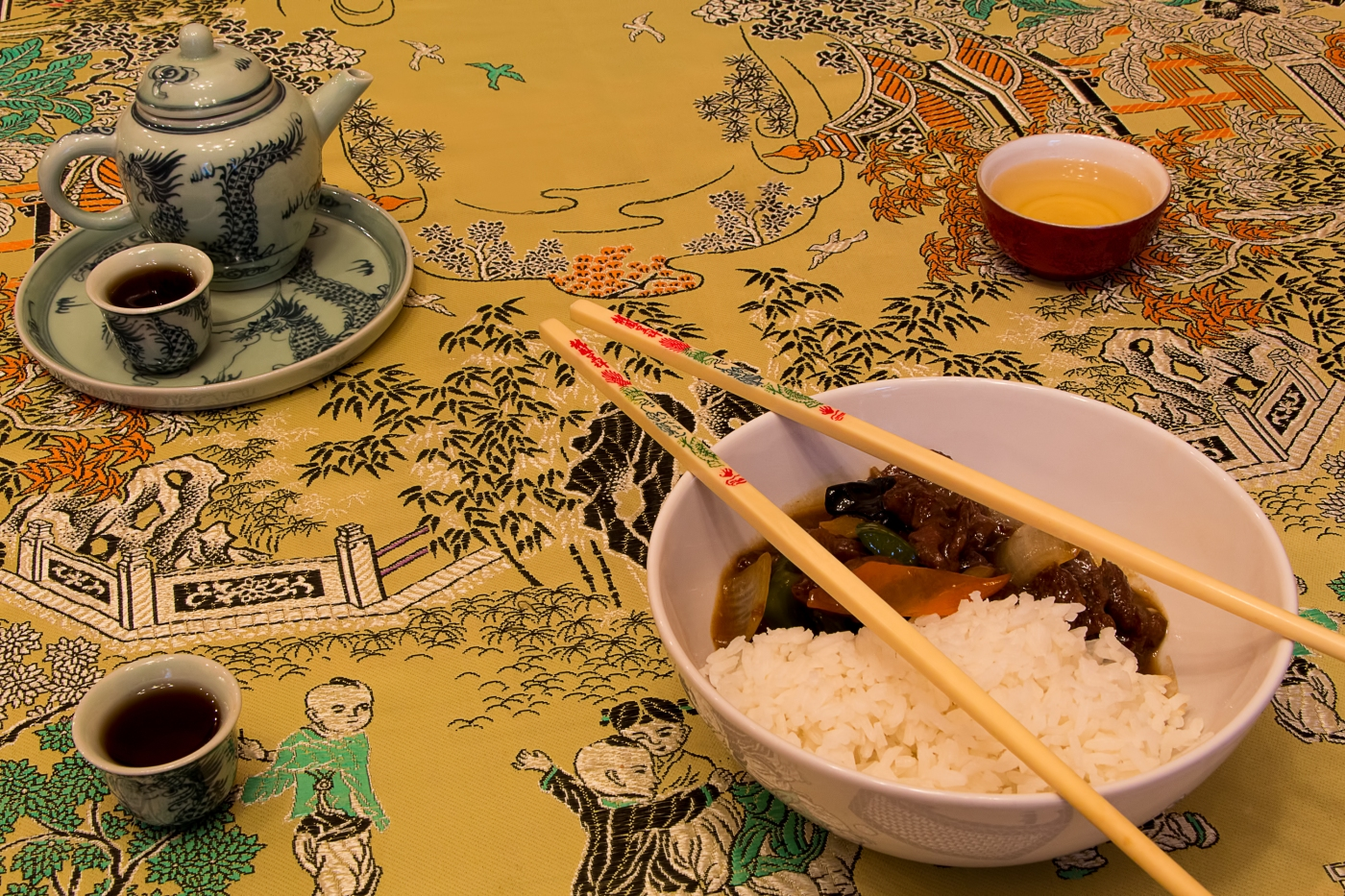 Chinese fast food served on a stylish tablecloth.